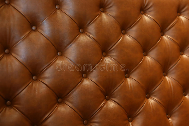 Luxury leather sofa furniture. Abstract luxury brown leather texture sofa furniture upholstery or wall interior decoration background royalty free stock photos