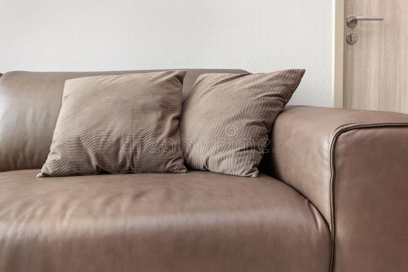 Luxury Leather Sofas with pillow. At condominium royalty free stock photo