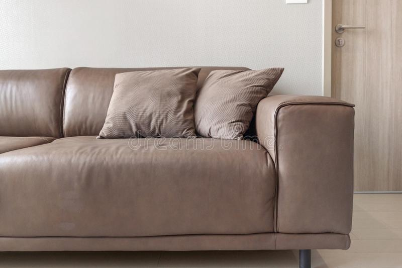 Luxury Leather Sofas with pillow. At condominium royalty free stock photography