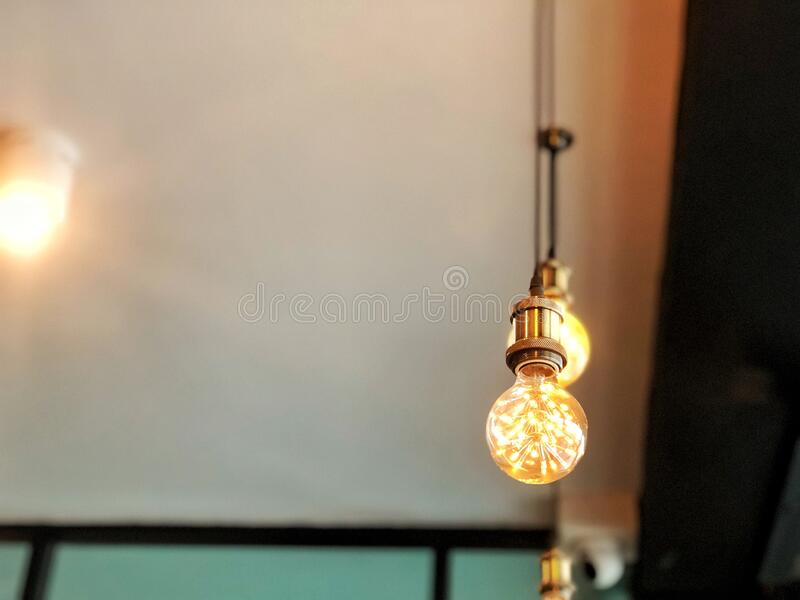 Luxury LED lamp lightbulb, orange light modern style decorate in a restaurant or home interior, power technology set up. stock photography