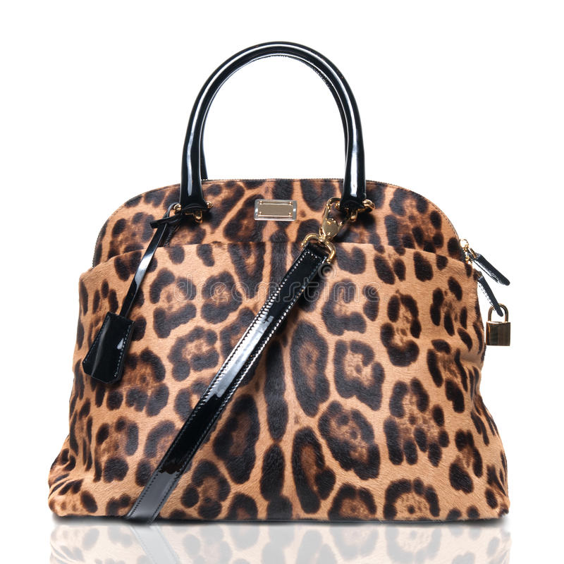 Luxury leopard female bag. Isolated on white stock photos