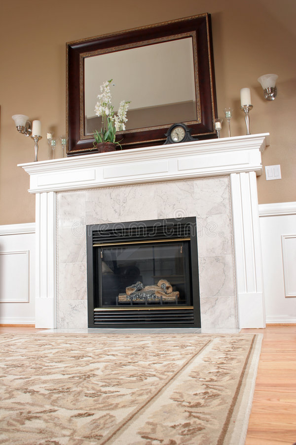 Luxury Living Room. A beautiful marble fireplace in a living room with a unique angle royalty free stock photos