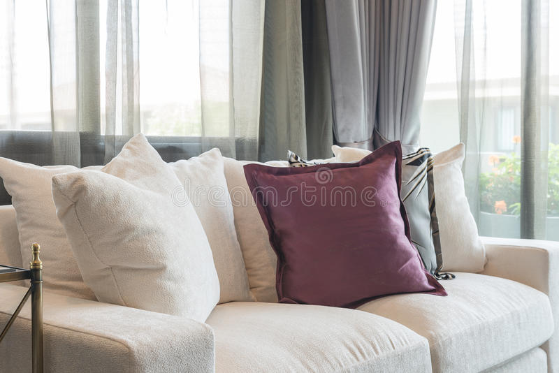 Luxury living room design with white sofa. And set of pillows stock image