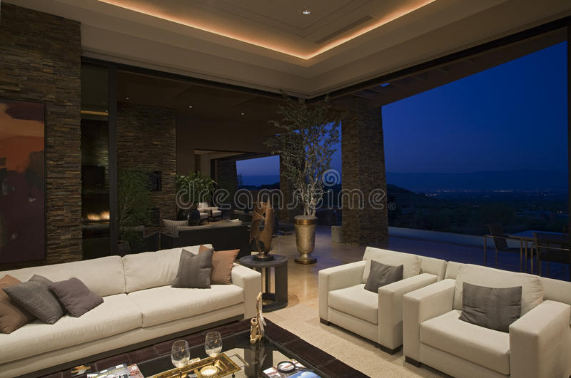 Luxury Living Room In House At Night royalty free stock images