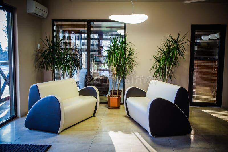 Luxury lobby interior.With comfortable sofa. Luxury lobby interior.With crystal lamp,bing hall, marble floor, french sash,mosaic tile,comfortable sofa royalty free stock photography