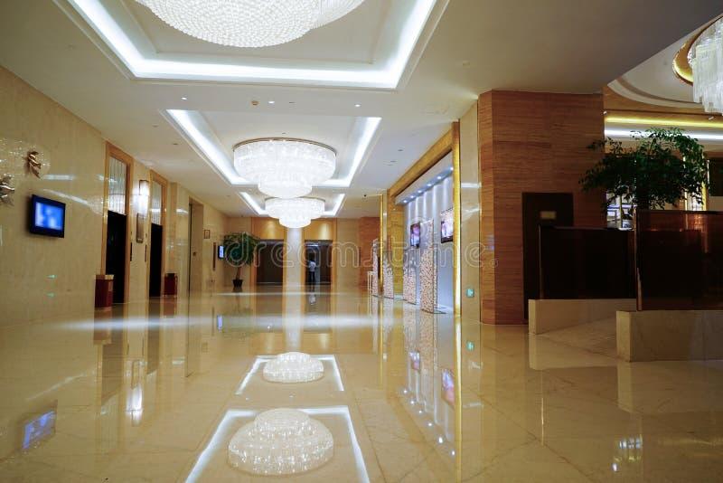 Luxury lobby interior. With crystal lamp,bing hall, marble floor, french sash,mosaic tile,comfortable sofa, etc stock photo