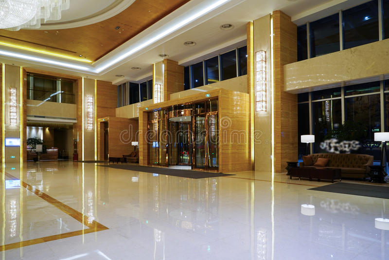 Luxury lobby interior. With crystal lamp,bing hall, marble floor, french sash,mosaic tile,comfortable sofa, etc royalty free stock photos