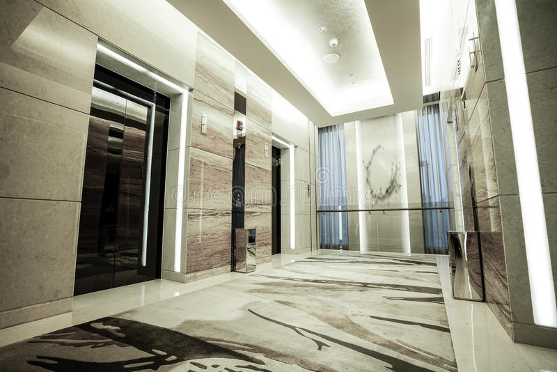 Luxury lobby interior. With crystal lamp,bing hall, marble floor, french sash,mosaic tile,comfortable sofa, etc stock image