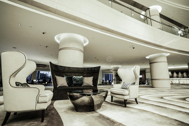 Luxury lobby interior. With crystal lamp,bing hall, marble floor, french sash,mosaic tile,comfortable sofa, etc royalty free stock images