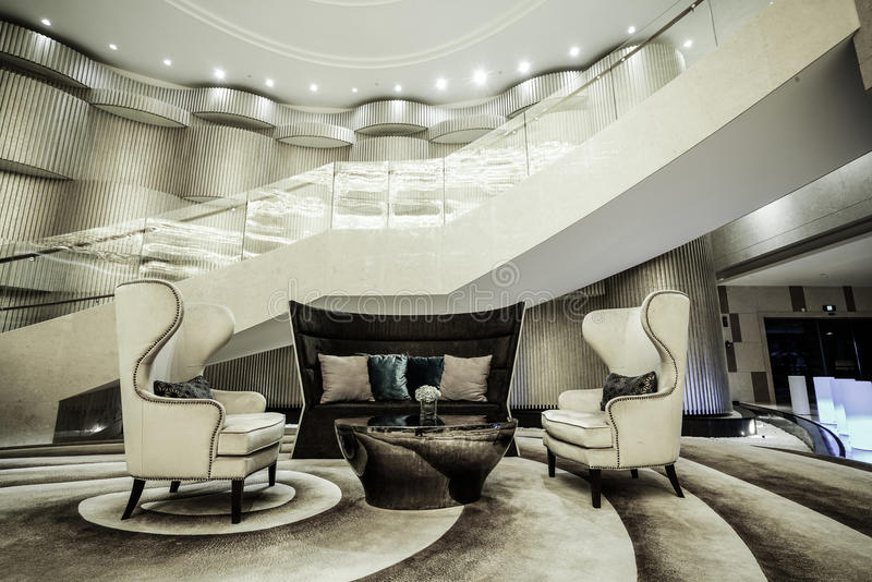 Luxury lobby interior. With crystal lamp,bing hall, marble floor, french sash,mosaic tile,comfortable sofa, etc stock photography