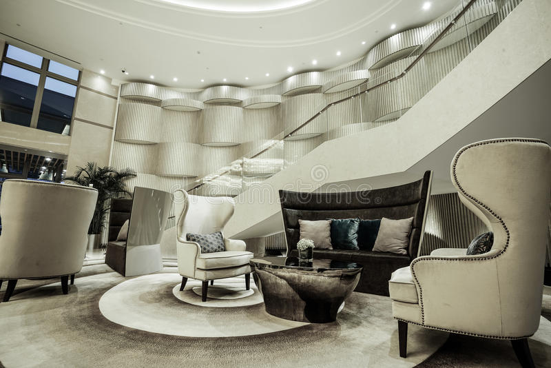 Luxury lobby interior. With crystal lamp,bing hall, marble floor, french sash,mosaic tile,comfortable sofa, etc royalty free stock image