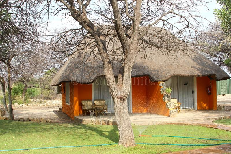Luxury resort cottage safari gardens , Namibia, Africa. Luxury resort Khorab Safari Lodge with bungalows with thatch roofs in nature reserve, Otavi, Namibia stock images