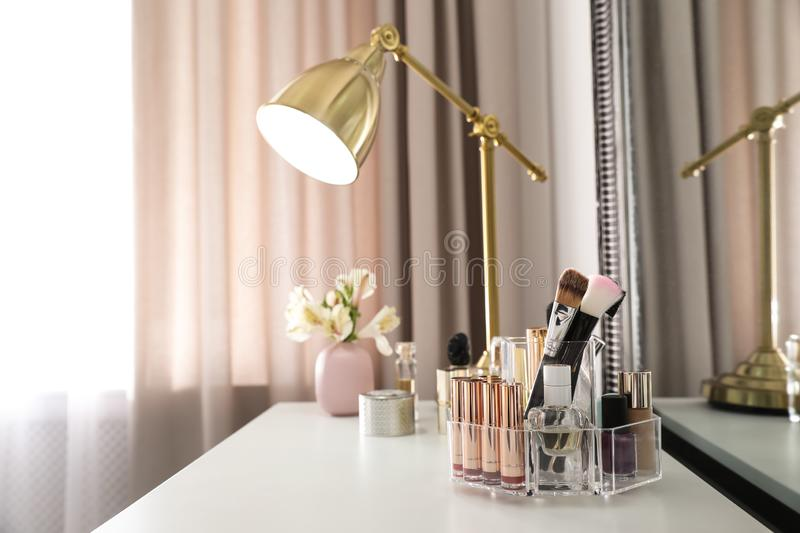 Luxury makeup products and accessories on dressing table with mirror royalty free stock photography