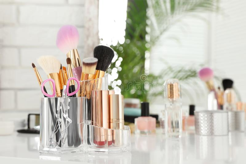 Luxury makeup products and accessories on dressing table with mirror stock images