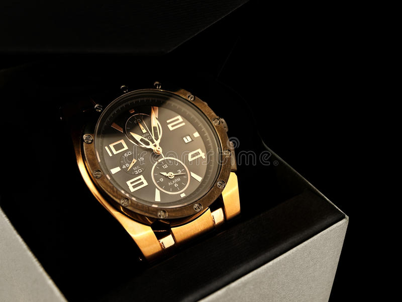 Luxury man watch. In gift box against black background royalty free stock photos