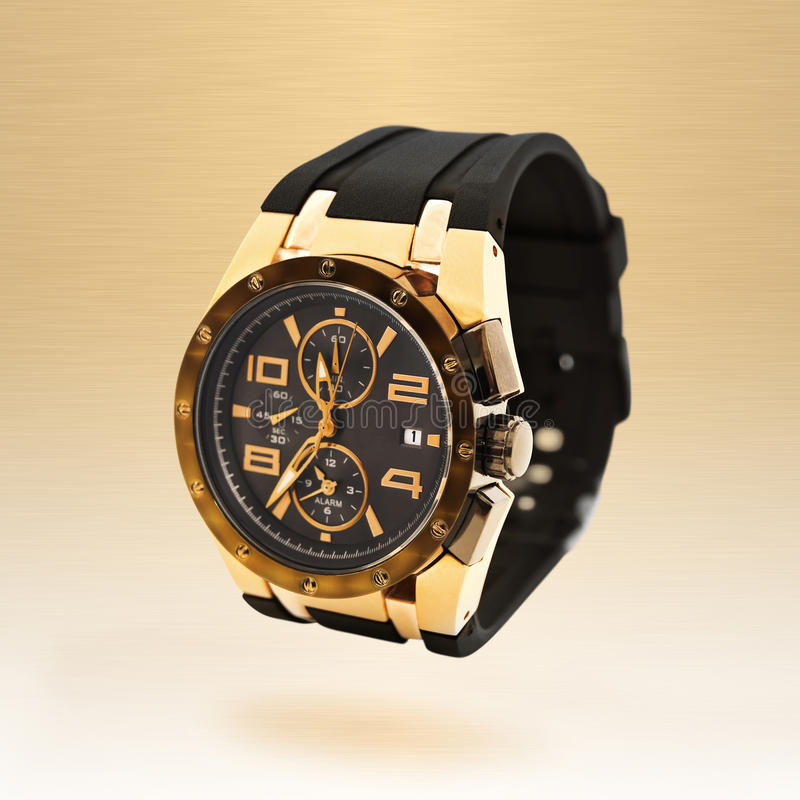 Luxury man watch. Against beige background royalty free stock image