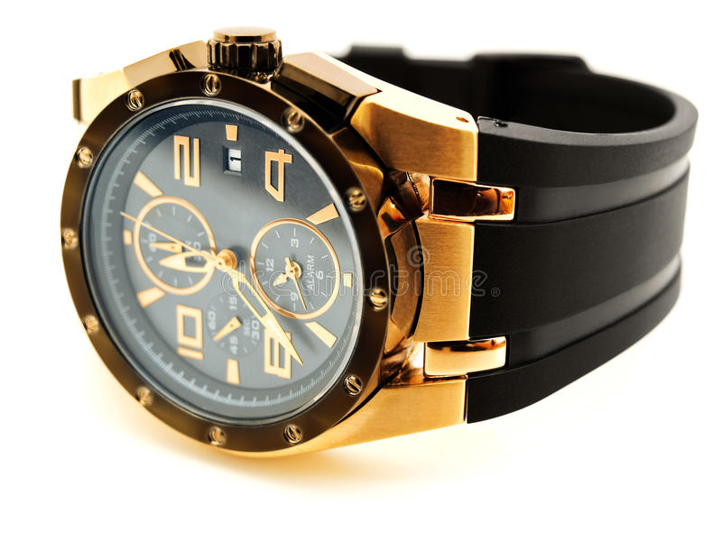 Luxury man watch. Luxury golden man watch against white background royalty free stock images