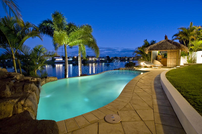 Luxury mansion outside deck with Bali hut stock photos
