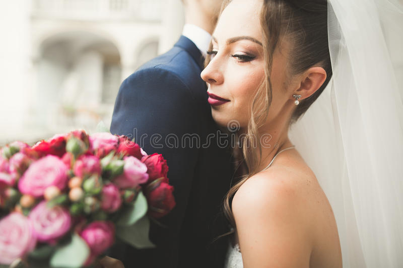 Luxury married wedding couple, bride and groom posing in old city.  royalty free stock photography