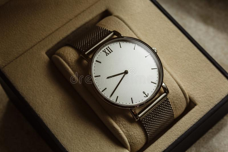 Luxury men`s watch in a gift box. Accessories for a businessman royalty free stock photo