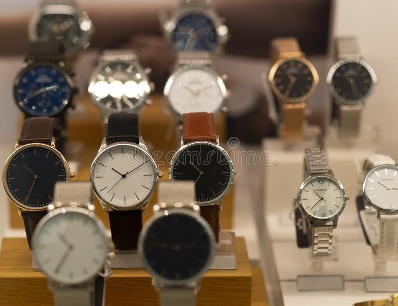 Luxury men`s watches in a store. Luxury watches in a store royalty free stock photography
