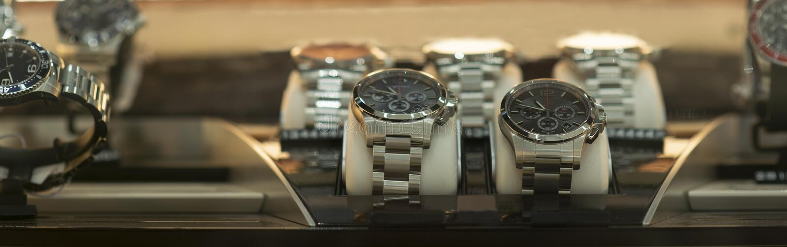 Luxury men`s watches at the store. Luxury watches in a store royalty free stock photos
