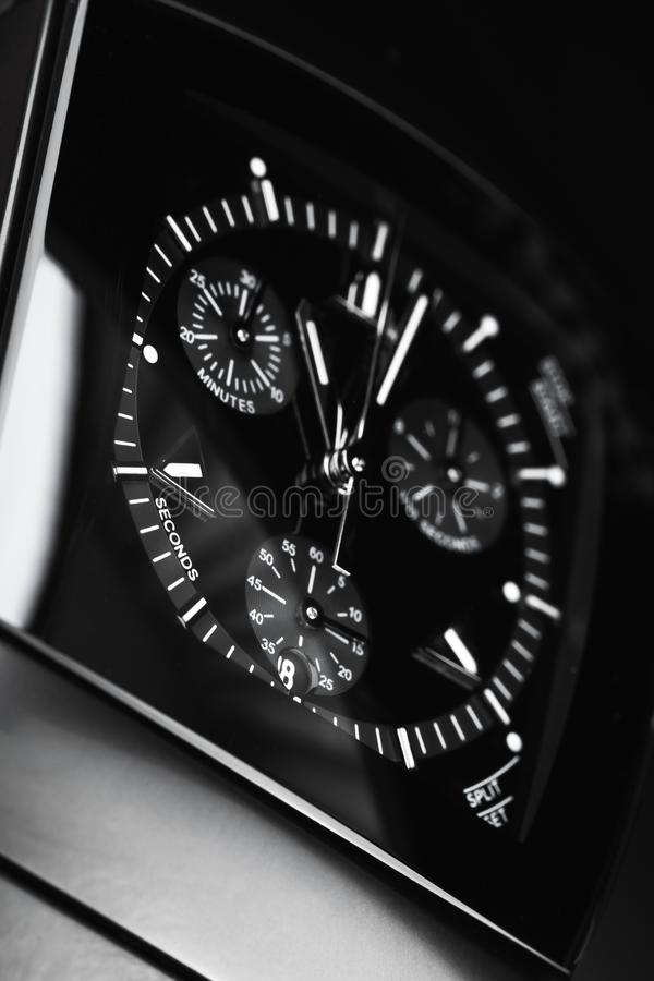 Luxury mens wrist watch, vertical photo. Luxury mens wrist watch made of black high-tech ceramics. Close-up studio photo with selective focus royalty free stock photo