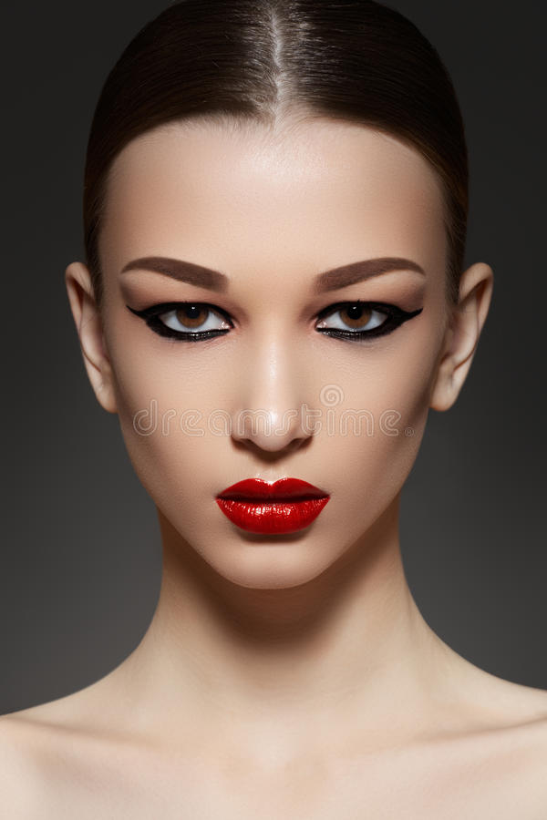 Luxury model face with fashion eyeliner make-up