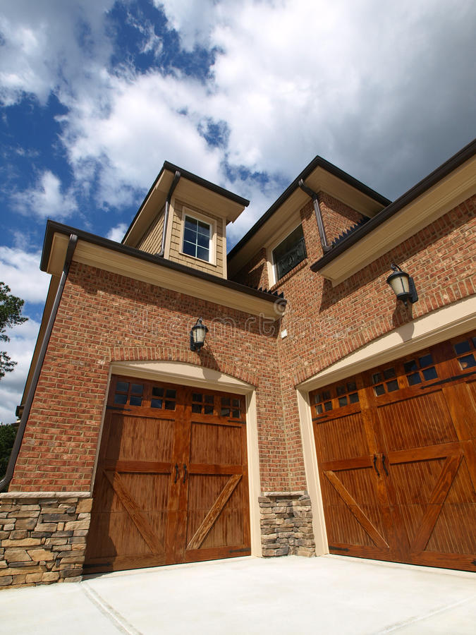 Luxury Model Home Exterior angled double garage stock photos
