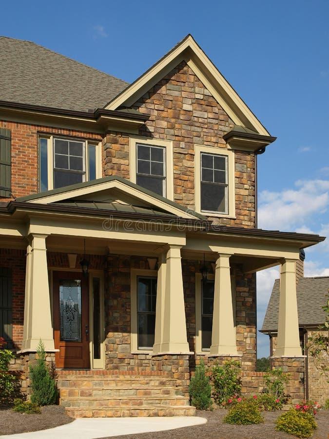 Luxury model home exterior column entrance stock photo for Luxury model homes