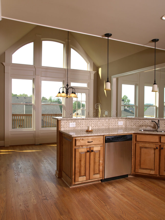 Luxury Model Home Maple Kitchen with window 3 royalty free stock image
