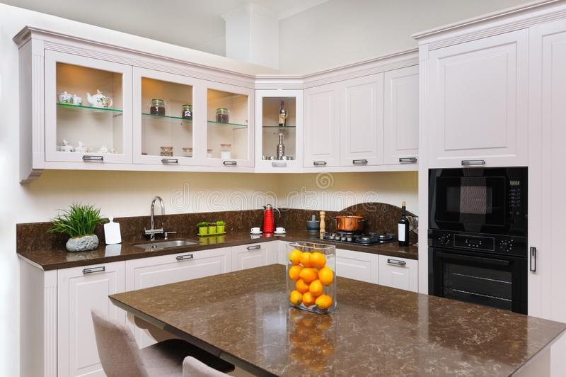 Luxury modern beige kitchen interior royalty free stock image