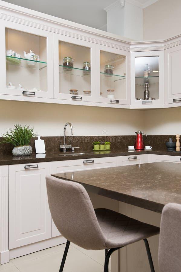 Luxury modern beige kitchen interior stock images