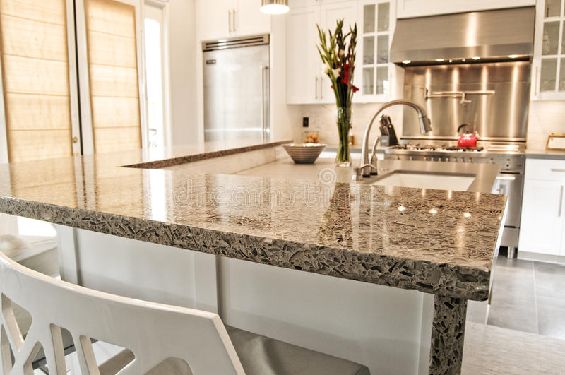 Luxury modern fitted kitchen with stainless steel royalty free stock photo