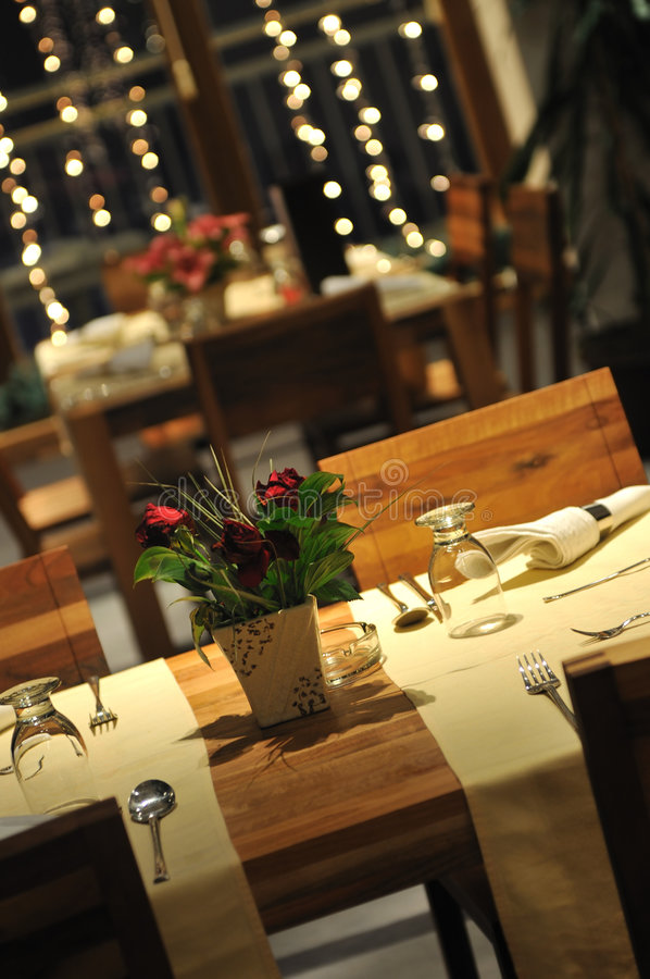 Luxury modern indoor restaurant. With wooden chairs and tables royalty free stock image