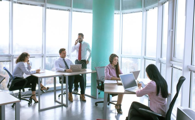Team working process on international project. Luxury modern office. Managers and team lead creating new project ideas. Business concept royalty free stock photo