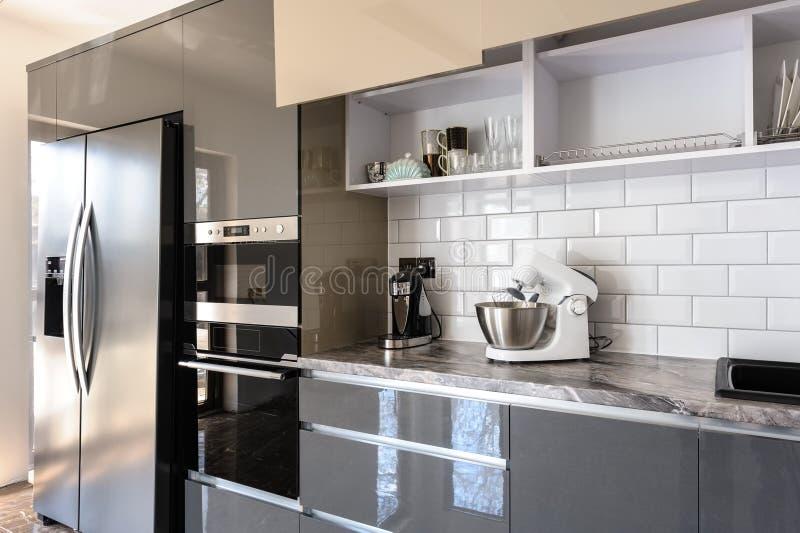 Luxury modern white, beige and grey kitchen interior stock photos