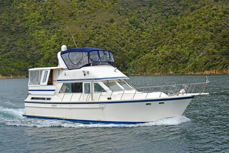 Luxury Launch Cruising in the Marlborough Sounds New Zealand royalty free stock photo
