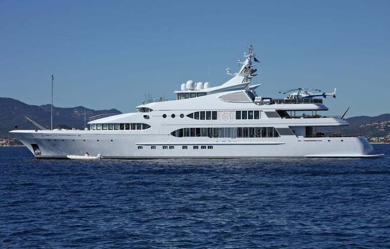 Luxury motor yacht. With helicopter at sea royalty free stock photo