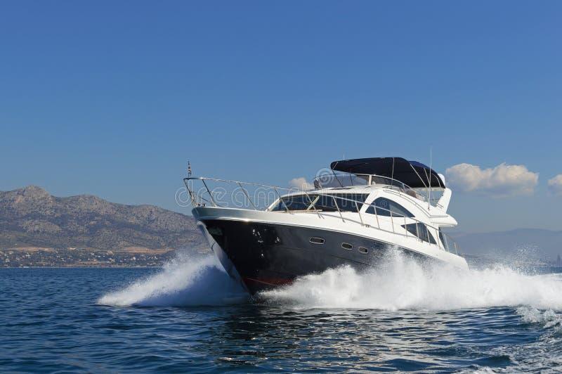 Luxury motor yacht at full speed royalty free stock photo