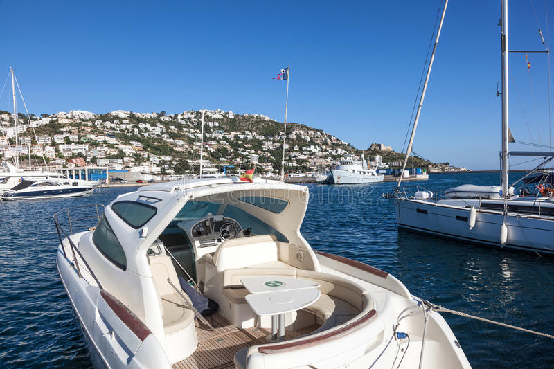 Luxury motorboat in Roses, Spain. Luxury yachts and motorboats in the marina of Roses, Catalonia, Spain royalty free stock photo