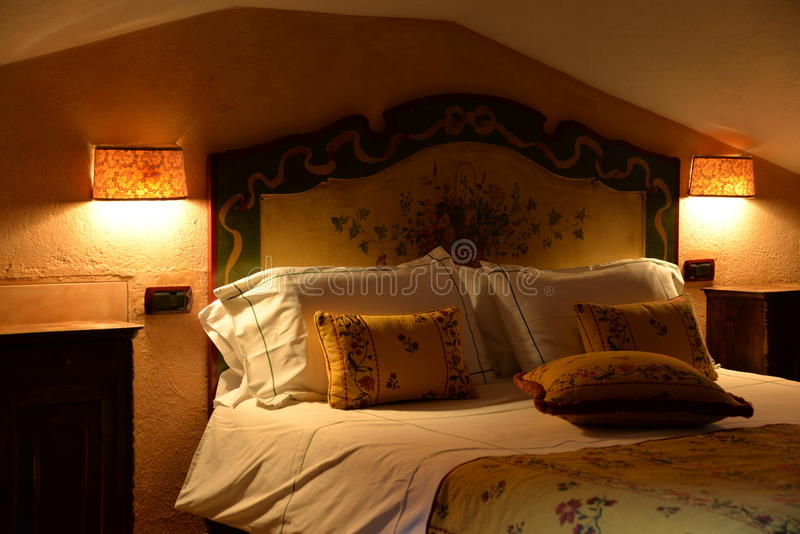 Luxury mountain hotel interior design. Sleeping room wooden furniture stock photo