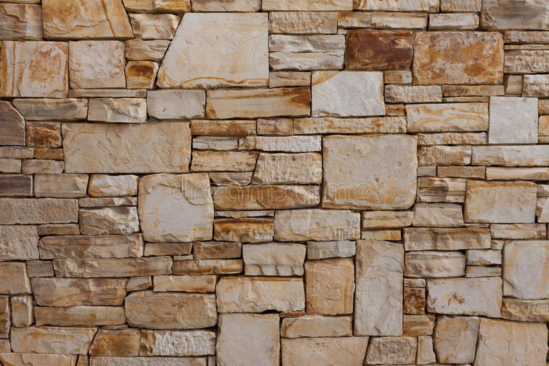 Luxury, natural stone brick wall pattern background. Upscale natural stone wall pattern or background; horizontal format The wall was designed and constructed royalty free stock photography