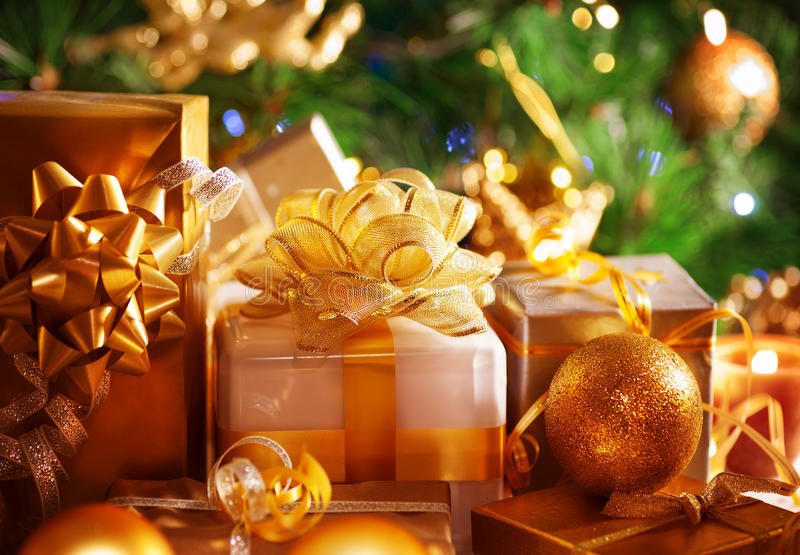 Luxury New Year gifts. Image of luxury New Year gifts, different present boxes under Christmas tree in holiday eve, Christmastime celebration, home decorated stock image