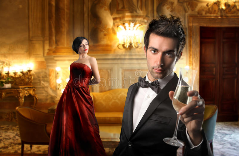 Luxury night. Elegant couple drinking wine in a luxury interior