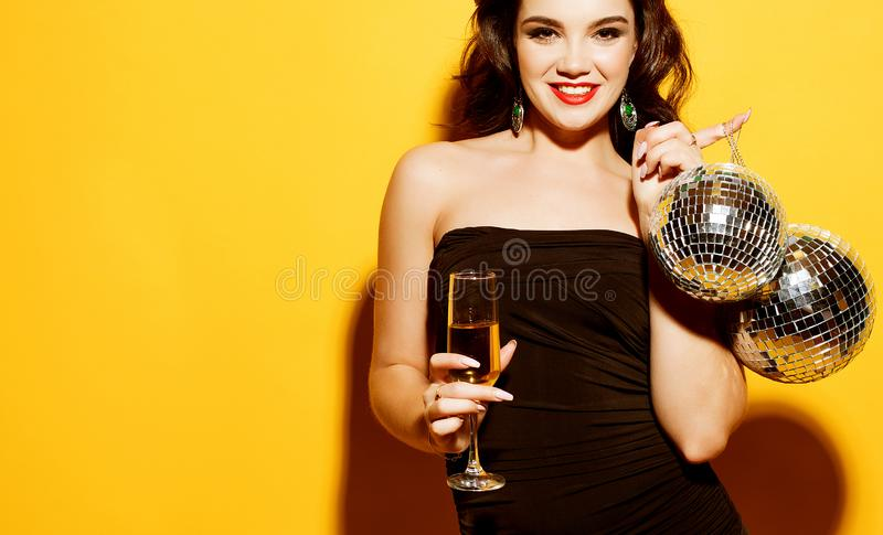 Luxury, nightlife, party concept - beautiful woman in evening dress with  white wine and disco ball. Luxury, nightlife, party concept - beautiful young woman in stock photos