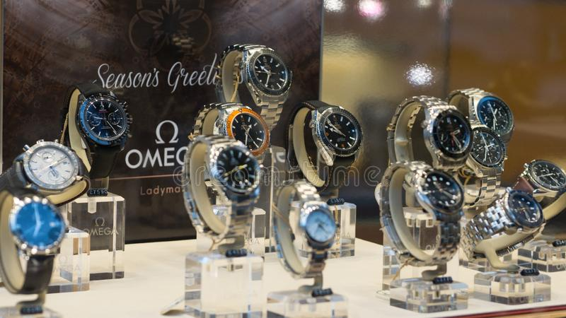 Luxury Omega Seamaster watches on display in store window, shallow depth of field. Luxury, expensive Omega Seamaster watches on display in a store window, in royalty free stock photos