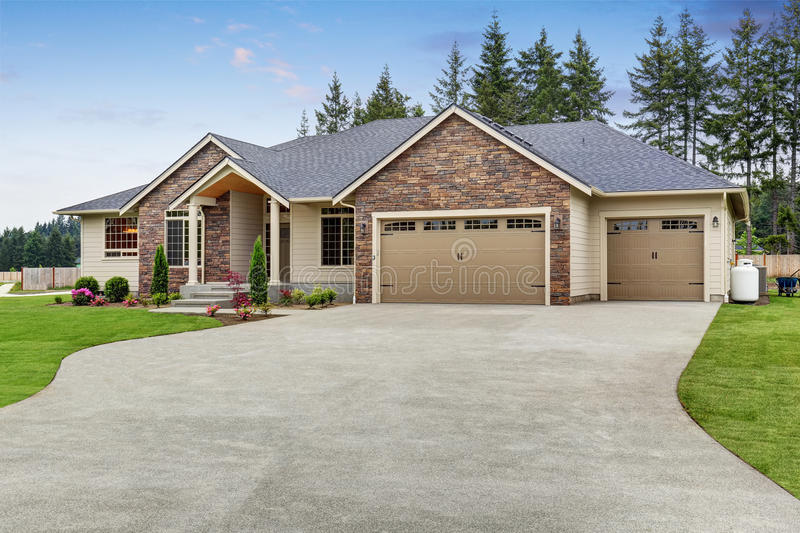 Luxury one level house exterior with brick trim and garage for Brick garages prices