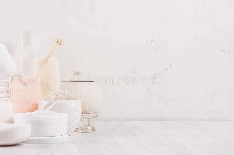 Luxury organic body and skin care spa light cosmetics collection and natural bath accessories on white wood background. royalty free stock photo