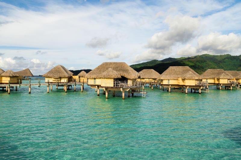 Luxury overwater villas. Bungalows over water in tropical dream destinations royalty free stock images
